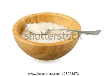 wood bowl and spoon with raw rice isolated on white - stock photo