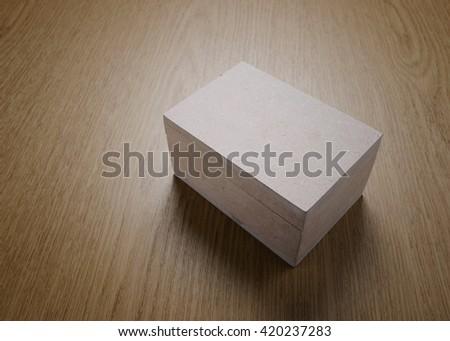 Wood box empty on wood background. - stock photo