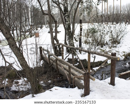 wood bridge in forest, in the park - stock photo