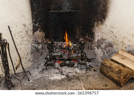 Wood burning at home fireplace - stock photo