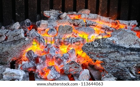 Wood burning fireplace house in the winter. - stock photo