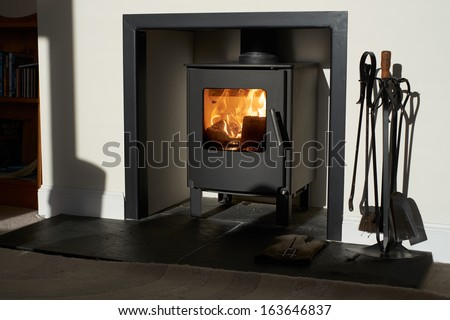 Wood burning stove, traditional heating system. Zero carbon footprint - stock photo