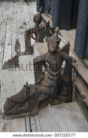 wood carved deva in Shwenandaw Kyaung Temple or Golden Palace Monastery in Mandalay, Myanmar., Bagaya Kyaung monastery, built in 1838 A.D of teak wood, ancient city Inwa (Ava) Mandalay, Myanmar - stock photo