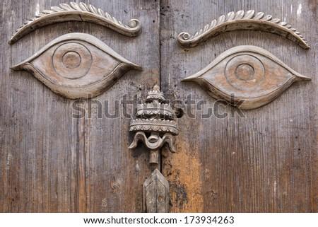 Wood carving of Buddha eyes in Kathmandu, Nepal - stock photo