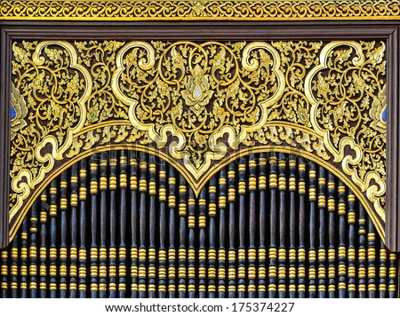 Wood carving patterns in Thailand temple. - stock photo