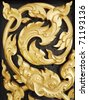Wood carvings is a form of Thai art and painted black paint over the designs with gold - stock photo
