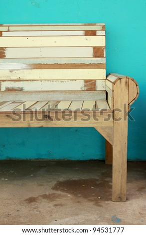 wood chair and green wall - stock photo