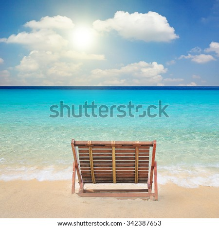 Wood chairs on the beach. - stock photo