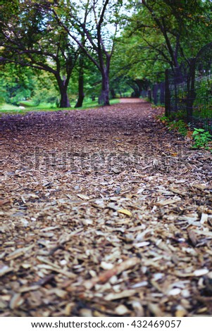Wood chips on part of bridle path along the west side of Central Park in New York City, USA - stock photo