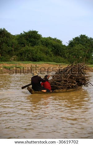 wood collecting fisherman adrift along the delta - stock photo