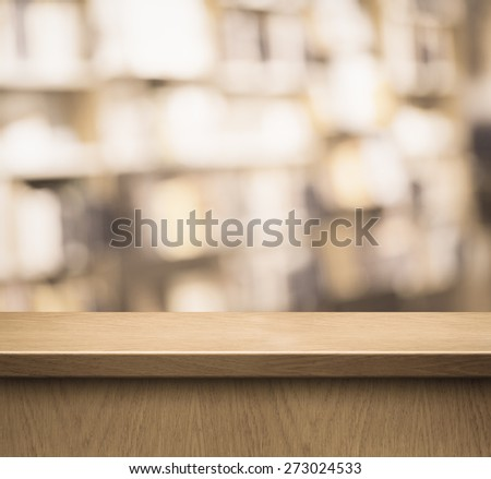 wood counter or reception desk in book shop or library - stock photo