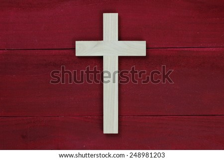 Wood cross on antique red wooden background - stock photo