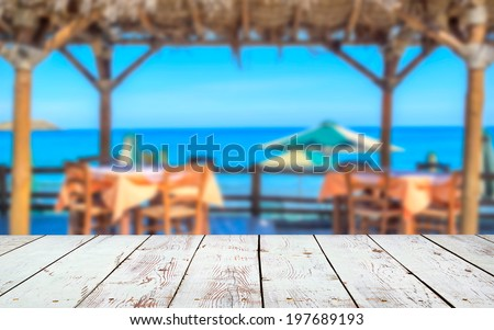 wood deck in front of beach landscape with sea view. - stock photo