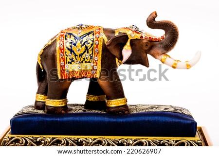 wood elephants in isolated on white background - stock photo