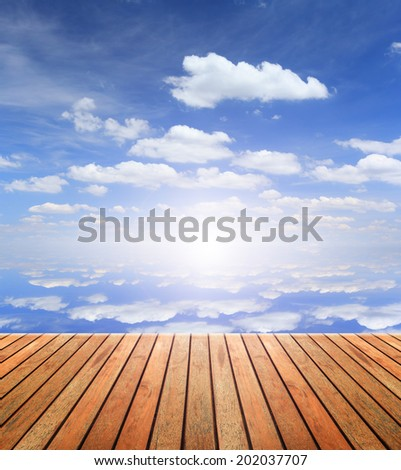 Wood floor and blue sky background  - stock photo