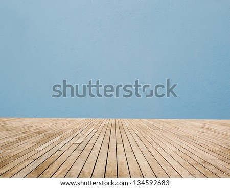 Wood Floor And Blue Wall - stock photo