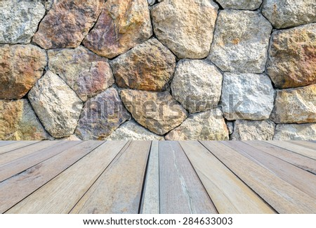 wood floor and stone wall backgrounds - stock photo