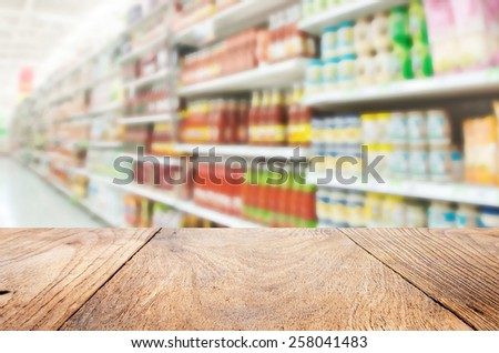 Wood floor and Supermarket blur background ,Product shelf sauce - stock photo