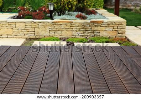 Wood floor over background beautiful modern decorative garden design. - stock photo