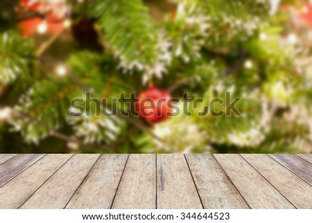 wood floor with decorations on the Christmas tree, Christmas blurred background - stock photo