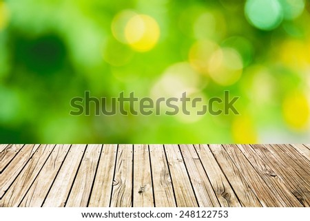 wood floor with green bokeh background - stock photo
