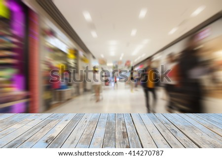 Wood floor with People  shopping in the supermarket, motion blur - stock photo