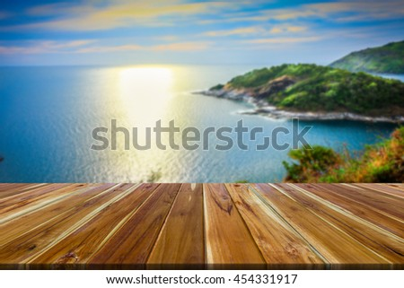 Wood floors table top with a natural backdrop. - stock photo