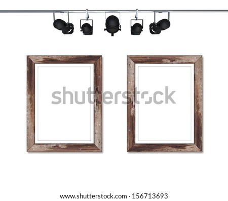 Wood frame with spotlight isolated on white  - stock photo