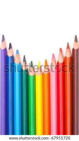 Wood-free resin triangular color pencils pointing up. - stock photo