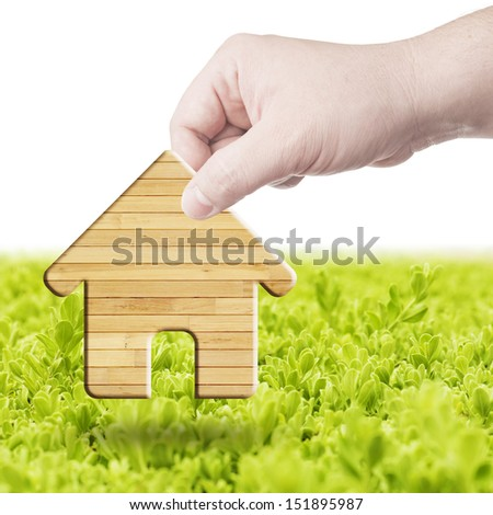 Wood house symbol on hand. Concept for building house - stock photo