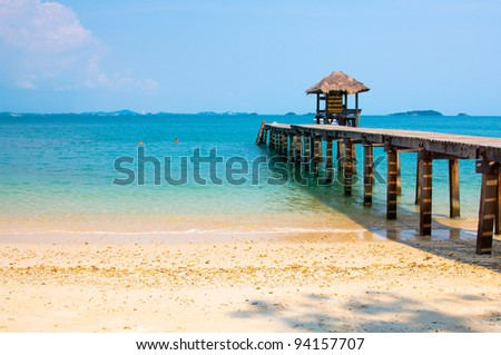 Wood jetty on the Beach and tropical sea,East of Thailand. - stock photo
