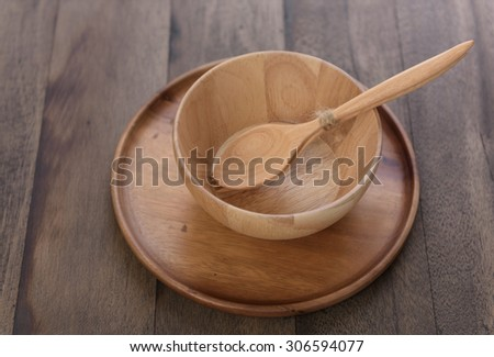 Wood kitchen utensils over grunge wooden table background - stock photo