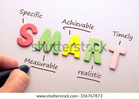 Wood letter of Smart word with hand writing definition for smart goal setting concept - stock photo
