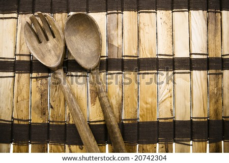 Wood Mat with Fork and Spoon - stock photo