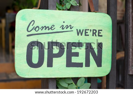 Wood open sign at the door of store - stock photo