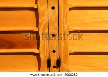 wood panel from side of vintage auto - stock photo