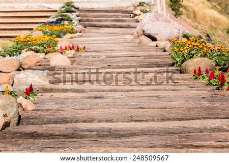 Wood pathway in the garden - stock photo