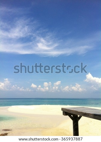 Wood pavilion on the white beach with a beautiful blue sky and fantastic cloud. At Mun Nork Island, Rayong, Thailand - stock photo