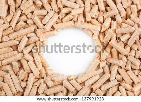 Wood pellets forming a frame - stock photo