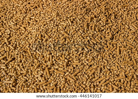 Wood pellets in the background. Biofuels. Cat litter. - stock photo