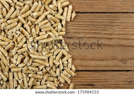 wood pellets on planks closeup - stock photo