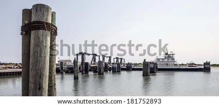 Wood Pilings and Boat at Port. - stock photo