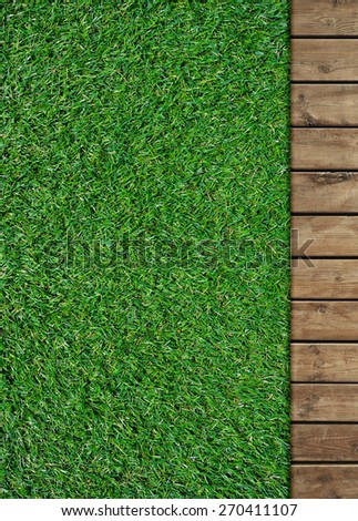 Wood plank with green grass texture background - stock photo