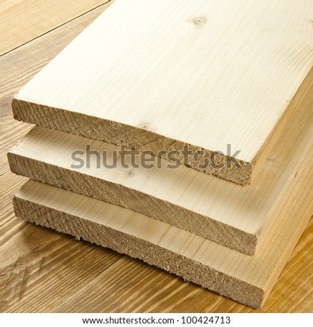Wood planks are on a wooden board - stock photo