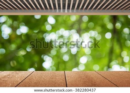 Wood planks floor and green bokeh background , abstract natural bright sun light background - stock photo
