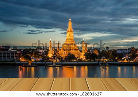 wood planks floor with Wat Arun at twilight background - stock photo