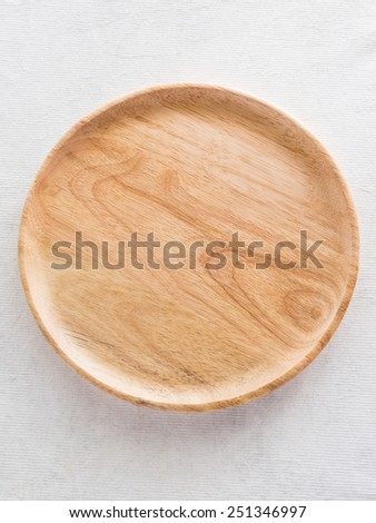 wood plate on the cloth in restaurant - stock photo