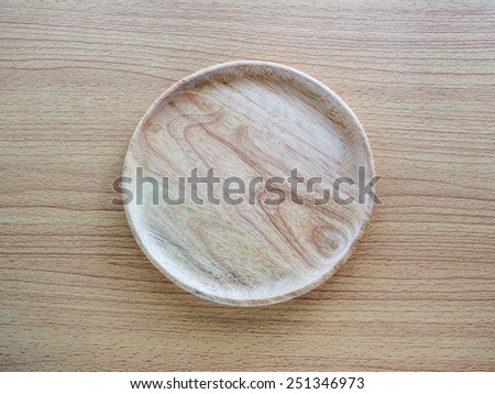 Wood plate on the table - stock photo