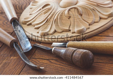 Wood processing. Joinery work. wood carving. a wood carvings, tools on the wooden background close up.  use as background - stock photo