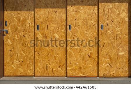 Wood pulp board doors. - stock photo